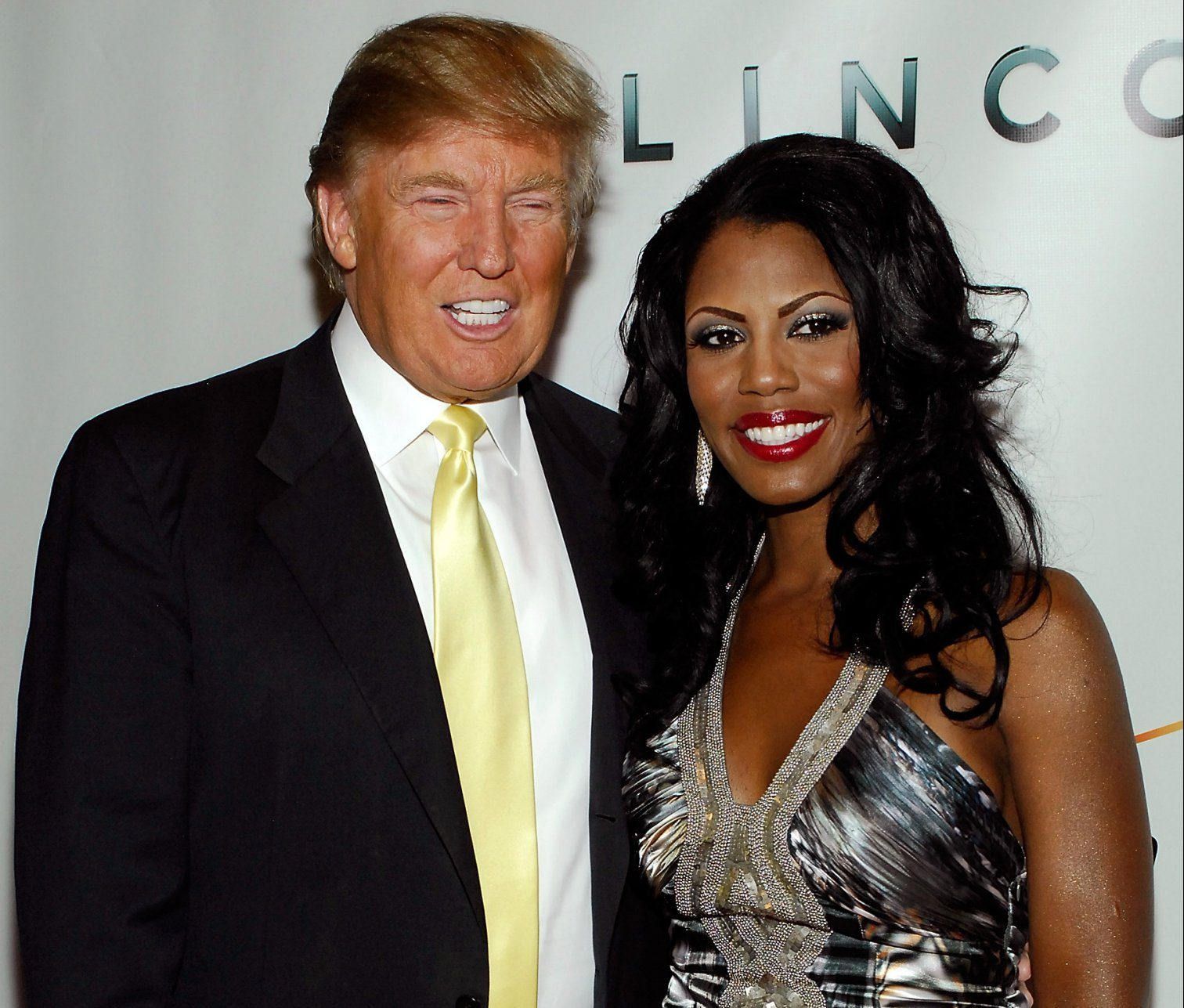 """NEW YORK - JUNE 14: Real estate developer/TV personality Donald Trump and TV personality Omarosa attend """"The Ultimate Merger"""" premiere at Trump Tower on June 14, 2010 in New York City. (Photo by Joe Corrigan/Getty Images)"""