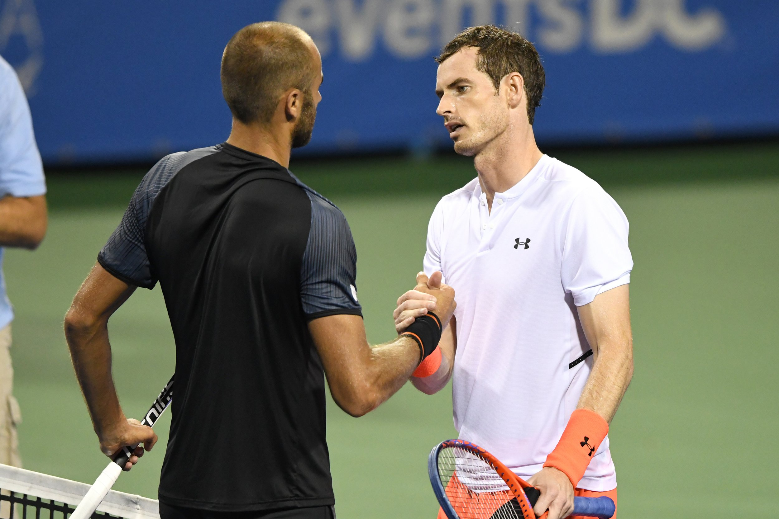 WASHINGTON, DC - AUGUST 02: Andy Murray of Great Britain shakes hands with Marius Copil of Romania after winning their match during Day Six of the Citi Open at the Rock Creek Tennis Center on August 2, 2018 in Washington, DC. (Photo by Mitchell Layton/Getty Images)