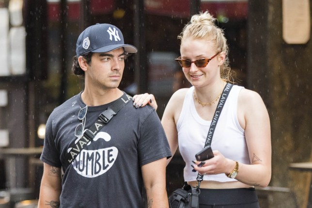 ** RIGHTS: WORLDWIDE EXCEPT IN GERMANY ** New York, NY - *EXCLUSIVE* - Joe Jonas and Sophie Turner are greeted by a Summer rain shower while out running errands. Joe and Sophie wait for rain to stop before they went home to get dry clothes. Pictured: Joe Jonas, Sophie Turner BACKGRID USA 3 AUGUST 2018 BYLINE MUST READ: Skyler2018 / BACKGRID USA: +1 310 798 9111 / usasales@backgrid.com UK: +44 208 344 2007 / uksales@backgrid.com *UK Clients - Pictures Containing Children Please Pixelate Face Prior To Publication*