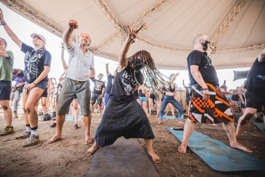 WACKEN, GERMANY - AUGUST 04: Festival visitors doing Metal Yoga during the Wacken Open Air festival on August 4, 2018 in Wacken, Germany. Wacken is a village in northern Germany with a population of 1,800 that has hosted the annual festival, which attracts heavy metal fans from around the world, since 1990. (Photo by Gina Wetzler/Getty Images)