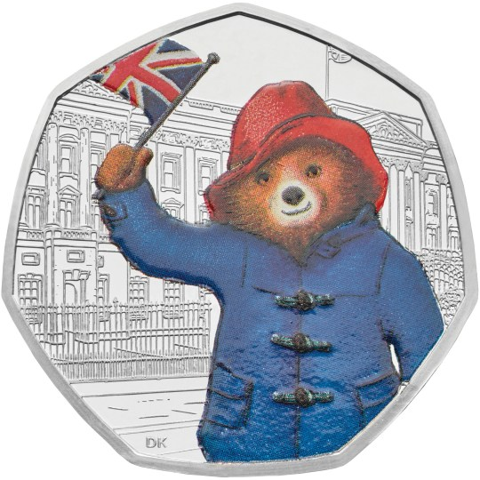 Embargoed to 0001 Monday August 6 Undated Royal Mint handout photo of a new Silver Proof Paddington Bear coin being released by the Royal Mint in celebration of the 60th anniversary of his first ever adventure in A Bear Called Paddington, the coin depicts the friendly Peruvian bear outside Buckingham Palace. PRESS ASSOCIATION Photo. Issue date: Monday August 6, 2018. Available in a range of finishes, the coins start at ?10 for a ?mint condition? Brilliant Uncirculated finish coin, whilst silver proof editions capture the vivid blue and vibrant reds of Paddington?s famous duffle coat and hat in minute detail. Photo credit should read: The Royal Mint/PA Wire NOTE TO EDITORS: This handout photo may only be used in for editorial reporting purposes for the contemporaneous illustration of events, things or the people in the image or facts mentioned in the caption. Reuse of the picture may require further permission from the copyright holder.