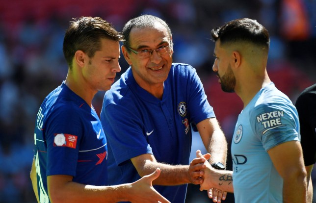 Soccer Football - FA Community Shield - Manchester City v Chelsea - Wembley Stadium, London, Britain - August 5, 2018 Chelsea manager Maurizio Sarri and Cesar Azpilicueta shake hands with Manchester City??s Sergio Aguero before the match REUTERS/Toby Melville
