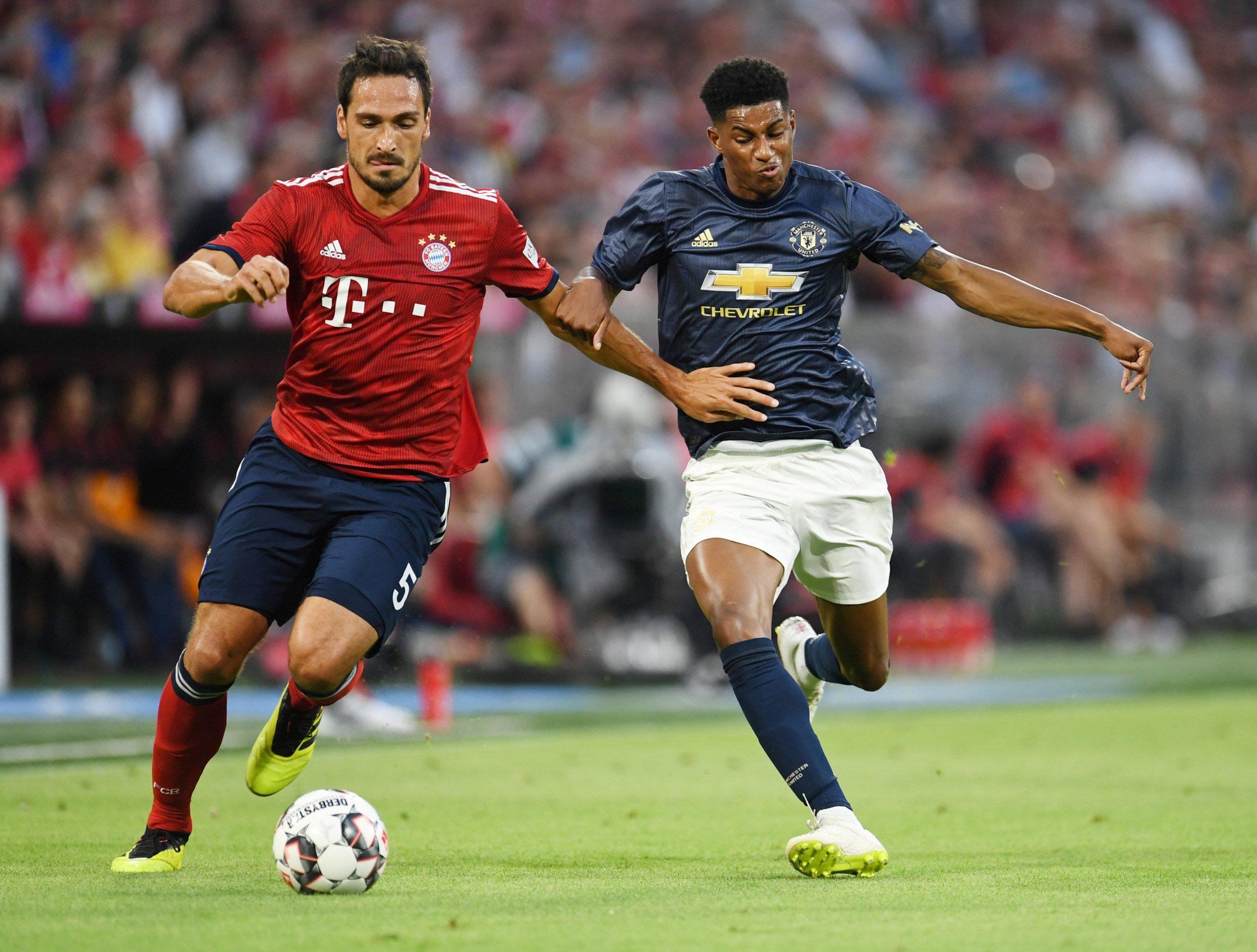 Soccer Football - Pre Season Friendly - Bayern Munich v Manchester United - Allianz Arena, Munich, Germany - August 5, 2018 Manchester United's Marcus Rashford in action with Bayern Munich's Mats Hummels REUTERS/Andreas Gebert
