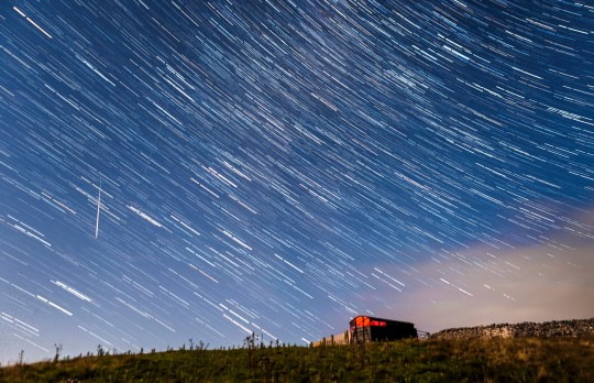 EDITORS NOTE: Digital composite of 30 photographs taken over a period of 15 minutes. A meteor and star trails during the Perseid meteor shower seen from near Hawes in the Yorkshire Dales National Park, as the Earth flies through a cloud of cometary dust creating a spectacular display of celestial fireworks.