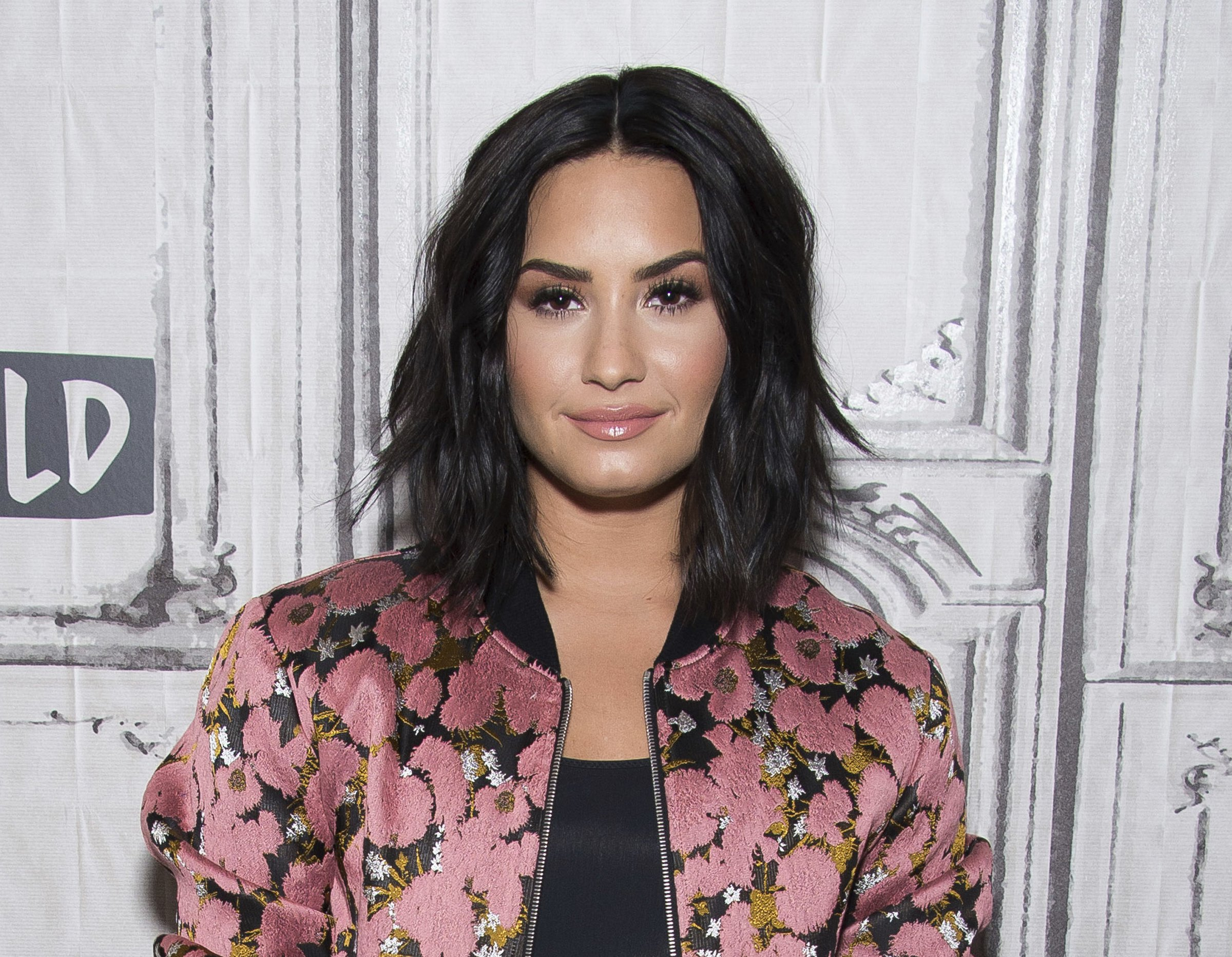 """FILE - In this March 20, 2017 file photo, Demi Lovato participates in the BUILD Speaker Series to discuss """"Smurfs: The Lost Village"""" in New York. Lovato has checked out of the hospital she was rushed to two weeks ago for a reported overdose. A person close to Lovato says she was released from Cedars-Sinai hospital in Los Angeles over the weekend. Lovato was hospitalized on July 24. (Photo by Charles Sykes/Invision/AP, File)"""