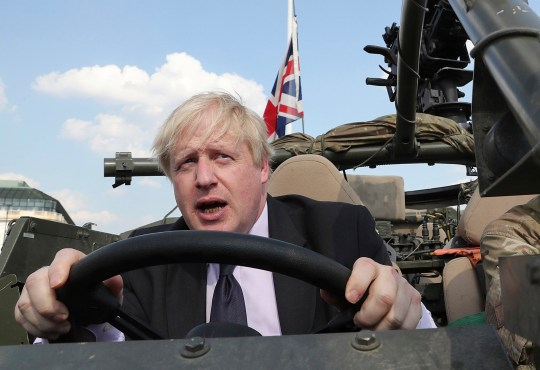 "FILE - In this file photo dated Thursday, June 21, 2018, Britain's Foreign Secretary Boris Johnson talks during a ceremony at the Tomb of the Unknown Soldier in Warsaw, Poland. The chairman of Britain's governing Conservative Party Brandon Lewis on Tuesday Aug. 7, 2018, asked former Foreign Secretary Boris Johnson to apologize for a newspaper column written by Johnson, that said burqa-wearing women looked like ""letter boxes"". (AP Photo/Czarek Sokolowski, FILE)"
