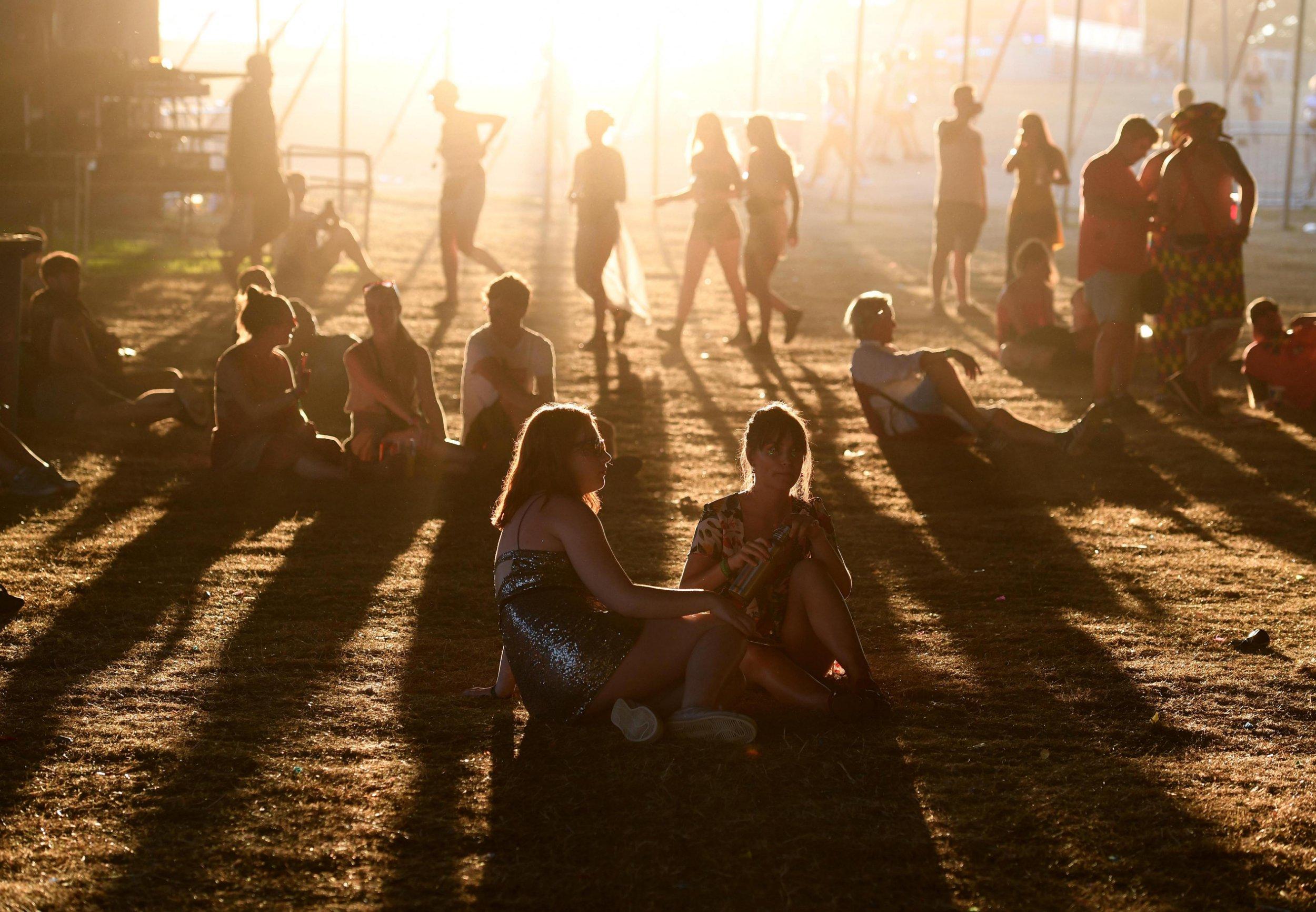 Mandatory Credit: Photo by Finbarr Webster/REX/Shutterstock (9779730cc) Festival goers at sunset Bestival, Dorset - 04 Aug 2018