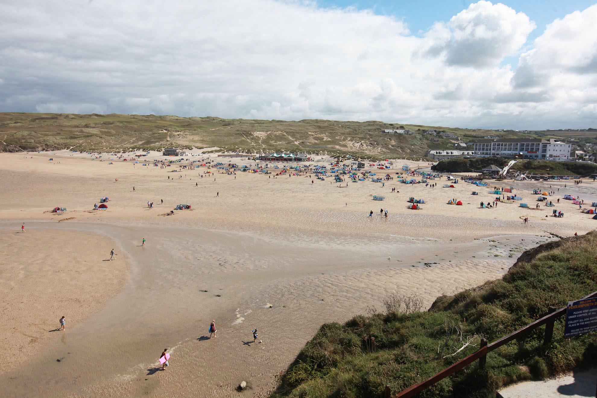 "PIC: APEX 09/08/2018 A wet fish beach-goer has been slammed after complaining that sand on a beauty spot beach was too damp for building sandcastles. The Trip Advisor review about Perranporth in Cornwall has been shared hundreds of times after being posted online. One person commented it was the funniest thing they had ever read while others said damp sand was preferable for sandcastles anyway. The reviewer who scored the two-mile long beach three out of five and said it was ""far too busy for my liking"" said: ""The beach itself looked really good for surfers, however I found the sand to be much too damp - not great for building sandcastles."" Those commenting suggested the writer ought to have moved up the beach, away from the sea. This file picture shows a general view of the beach at Perranporth. ** SEE STORY BY APEX NEWS - 01392 823144 ** ---------------------------------------------------- APEX NEWS AND PICTURES NEWS DESK: 01392 823144 PICTURE DESK: 01392 823145"
