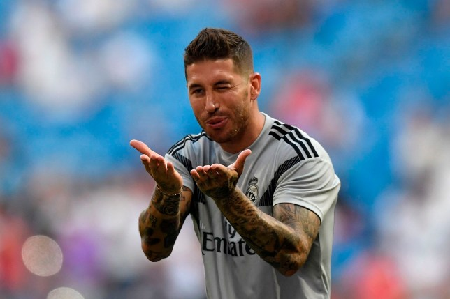 Real Madrid's Spanish defender Sergio Ramos salutes fans before the Santiago Bernabeu Trophy football match between Real Madrid and AC Milan in Madrid on August 11, 2018. (Photo by GABRIEL BOUYS / AFP)GABRIEL BOUYS/AFP/Getty Images