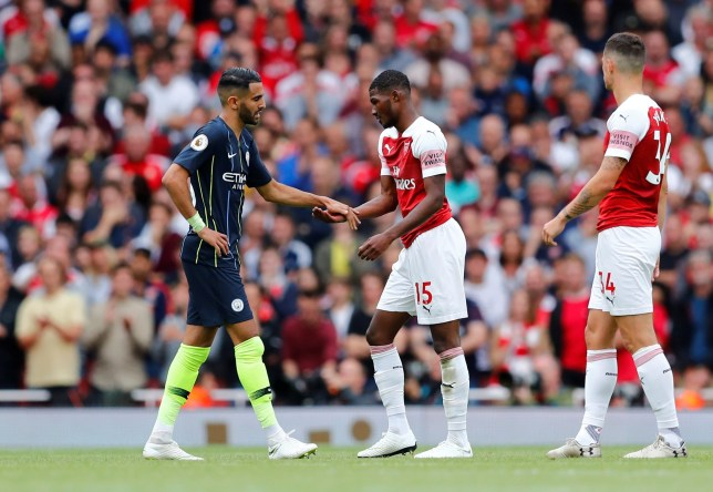 """Soccer Football - Premier League - Arsenal v Manchester City - Emirates Stadium, London, Britain - August 12, 2018 Arsenal's Ainsley Maitland-Niles shakes hands with Manchester City???s Riyad Mahrez as he leaves the pitch after sustaining an injury REUTERS/Eddie Keogh EDITORIAL USE ONLY. No use with unauthorized audio, video, data, fixture lists, club/league logos or """"live"""" services. Online in-match use limited to 75 images, no video emulation. No use in betting, games or single club/league/player publications. Please contact your account representative for further details."""