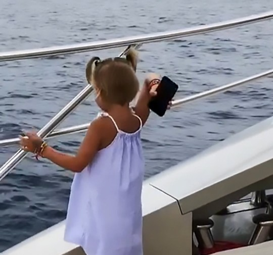 """Pic Shows: Timur's daughter throws his phone in the water; This is the moment a rapper???s spoilt little four-year-old daughter throws his smartphone into the sea in order to get him to pay attention to her. Russian rapper Timati, 34, was speaking on his phone on a yacht while his daughter Alisa was trying to get his attention. She suddenly grabs the phone out of her father's hand, turns around and throws it over the side of the boat before he has chance to react. The tattooed rapper looks at his daughter in shock before jumping up to see his phone has disappeared under the water. Alisa is Timati's daughter with his former girlfriend, glamour model and beauty queen, Alena Shishkova, 24. The incident was caught on camera by somebody else on the yacht who was filming Timati and Alisa at the time. And the video has gone viral online, notching up nearly 5.7 million views, after Timati shared it with his 12.3 million followers on Instagram. Some viewers blamed the little girl's parents for not bringing her up to be more respectful - while others thought the clip had been staged. Netizen ???Petr Zadera??? said: """"This child is out of order. Timati is the one to blame for her bringing her up this way. Let him now enjoy the results"""", and ???pepsi_172018??? added: """"What a hysterical monster."""" But ???dmitriy_smolkin??? argued: """"Seriously, why the cheap staged video?!"""", and ???milashka9128??? agreed: """"That was certainly staged."""" Apart from his successful career as a rap singer, Timati is also a businessman with his own clothing line, restaurant and tattoo shop. Alisa's mum meanwhile has modelled on fashion catwalks and for Maxim magazine. She was a runner-up in the Miss Russia 2012 beauty pageant."""