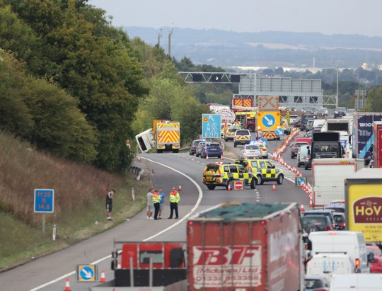 The scene on the the M25 exit slip road at J3, at Swanley on the anti-clockwise carriageway, after a coach overturned just before 4pm. PRESS ASSOCIATION Photo. Picture date: Monday August 13, 2018. See PA story ACCIDENT M25. Photo credit should read: Gareth Fuller/PA Wire