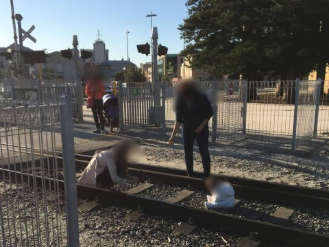 Mum puts baby on railway track so she can take photos