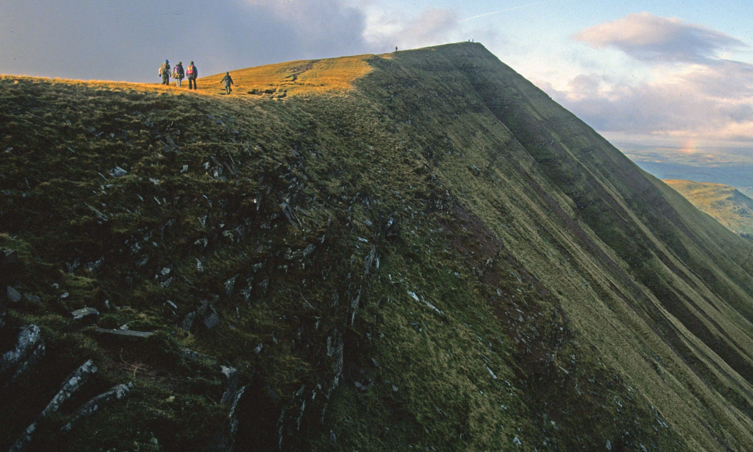 BNPS.co.uk (01202 558833)?Pic: MyrddynPhillips/BNPS Looking from the coll to the summit of Fan y Big. Technical KO - Welsh 'mountain' to loses its status after rechecking its vital statistics. Wales has lost a mountain after one of its peaks was reclassified on a 'technicality'. Impressive Fan y Big, in the Brecon Beacons, has been downgraded after an eagle eyed mountain surveyor measured it and found it didn't meet the stringent criteria. Mountains are required to be at least 2,000ft high (609.6m) and in the case of Fan y Big have a minimum drop between the summit and col of 30m (98ft 5in). Fan y Big has no problem conforming to the first category with its accurately surveyed height of 2,351ft (716.7m) But its drop has now been measured at 93ft 6in (28.5m), 4ft 11in (1.5m) less than what is required to maintain its mountain status.
