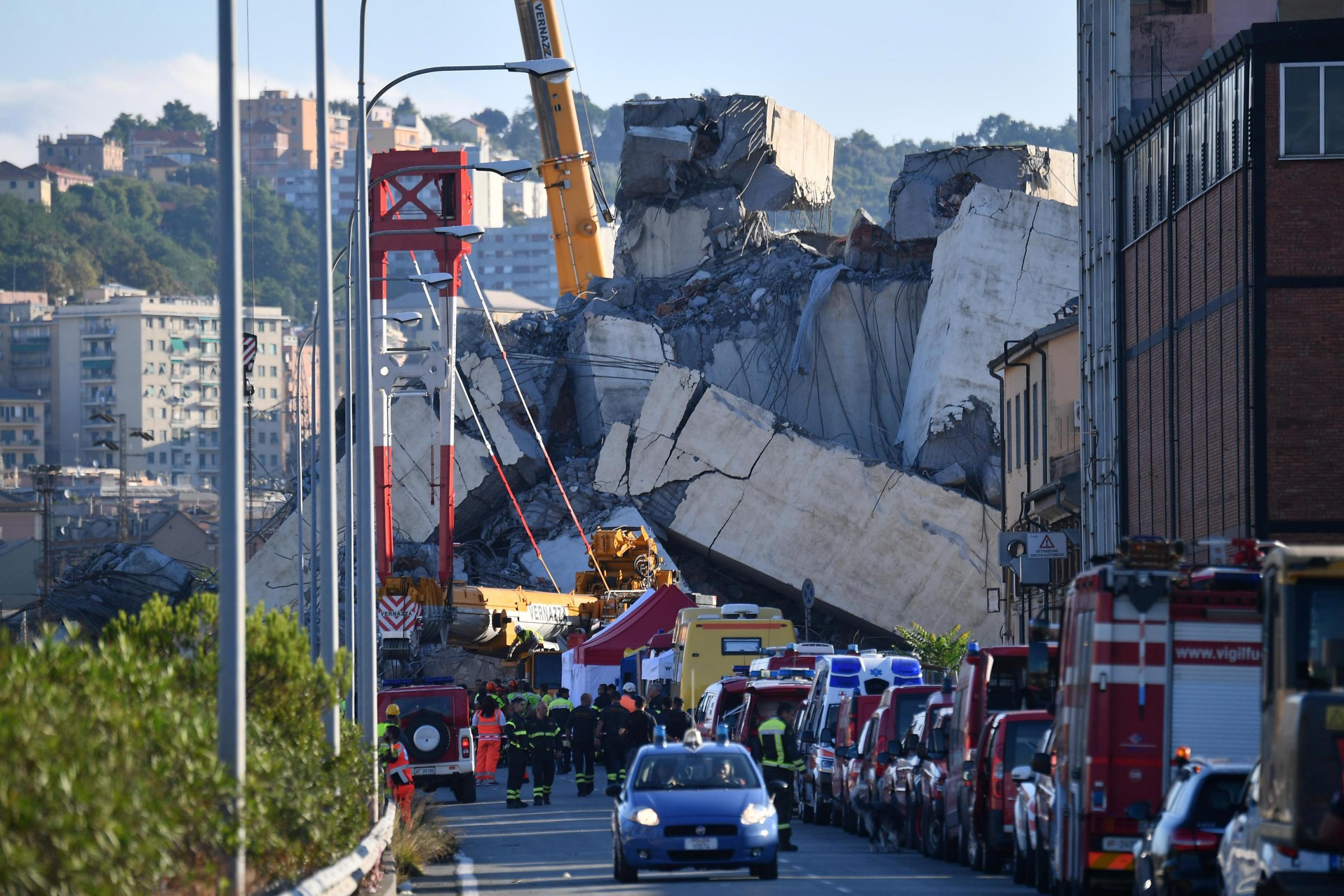 epaselect epa06950684 A general view of the collapsed Morandi bridge the day after the disaster in Genoa, Italy, 15 August 2018. The death toll for Tuesday's highway-bridge-collapse disaster in Genoa has risen to 37, according to reports on 15 August. EPA/LUCA ZENNARO