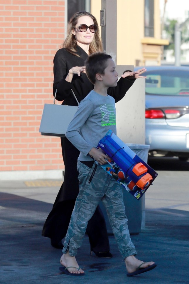 Los Feliz, CA - *EXCLUSIVE* - Actress Angelina Jolie was spotted doing some some shopping with Shiloh and Knox Jolie-Pitt at a few stores in Los Feliz. Knox seemed happy with a Nerf gun that he was spotted carrying out while Shiloh held on to bags filled with pet supplies. Angelina was recently ordered to return to the U.S. by judge in her divorce case. The actress and her ex Brad have been making headlines again with their divorce as they continue to work out an agreement relating to custody and child support of their six children. Pictured: Angelina Jolie, Knox Jolie-Pitt BACKGRID USA 15 AUGUST 2018 USA: +1 310 798 9111 / usasales@backgrid.com UK: +44 208 344 2007 / uksales@backgrid.com *UK Clients - Pictures Containing Children Please Pixelate Face Prior To Publication*