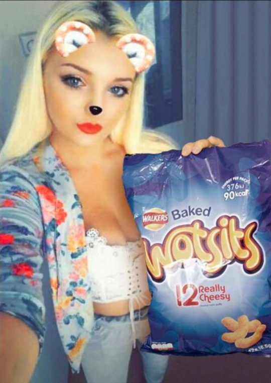 PIC FROM Kennedy News and Media (PICTURED: TACHA WARD AND HER FAVOURITE WOTSITS CRISPS THAT SHE CLAIMS THE MOUSE ALSO LOVES) A crisp-lover claims a sneaky mouse with the 'same tastes' as her nicked FOURTEEN BAGS of her favourite Wotsits - but repeatedly leaves behind all the flavours she doesn't like. Tacha Ward, 21, says the unwanted intruder is ???doing her head in??? and even caused an argument with her partner when she accused HIM of stealing her Wotsits. The snack fanatic had bought a huge Walkers variety box with more than 40 bags of Quavers, Monster Munch and her favourite Wotsits in it. SEE KENNEDY NEWS COPY - 0161 660 8596