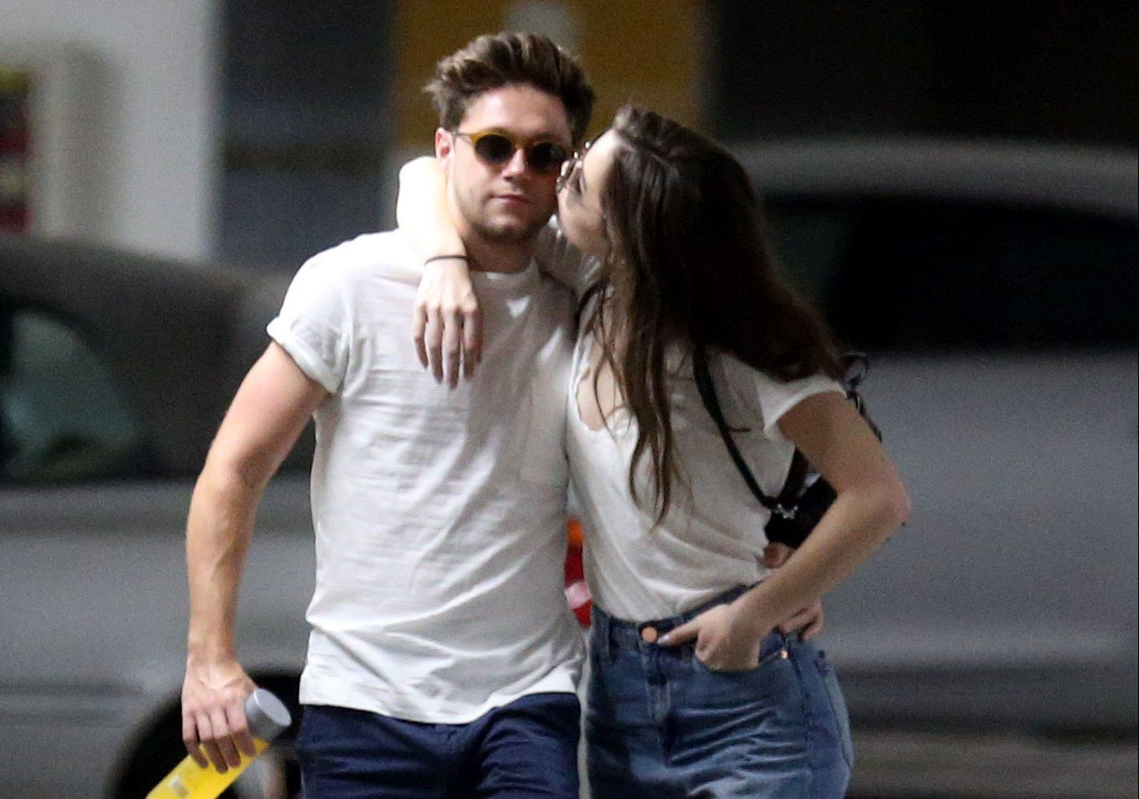 EXCLUSIVE: *PRINT AND ONLINE 250GBP P/PIC, 500GBP SET FEE* Niall Horan kisses Hailee Steinfeld as they head to Target in Los Angles, California. Rumours that the two were a couple surfaced in February when they were spotted at a Backstreet Boys concert together, although they have never confirmed their relationship status publicly. On their shopping trip, however, they were happy to indulge in a public display of affection, openly hugging and kissing as they waited for the elevator. Spending around 15 minutes in the store, Hailee purchased a WarmMist humidifier and carried it back to the car as Niall carried some bottles of water for the pair. The happy couple were also sartorially in sync, both wearing white t-shirts and blue shorts and jeans matched with white trainers. Pictured: Niall Horan,Hailee Steinfeld Ref: SPL5016354 150818 EXCLUSIVE Picture by: Splash News / SplashNews.com *PRINT AND ONLINE 250GBP P/PIC, 500GBP SET FEE* Splash News and Pictures Los Angeles: 310-821-2666 New York: 212-619-2666 London: 0207 644 7656 Milan: +39 02 4399 8577 Sydney: +61 02 9240 7700 photodesk@splashnews.com World Rights