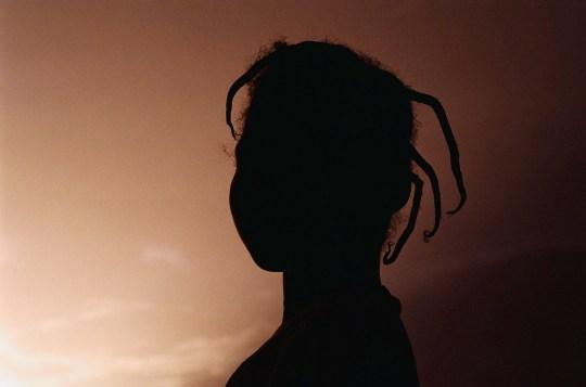 1996, Segou, Mali --- Silhouette of Malian Girl --- Image by ? Paul W. Liebhardt/CORBIS