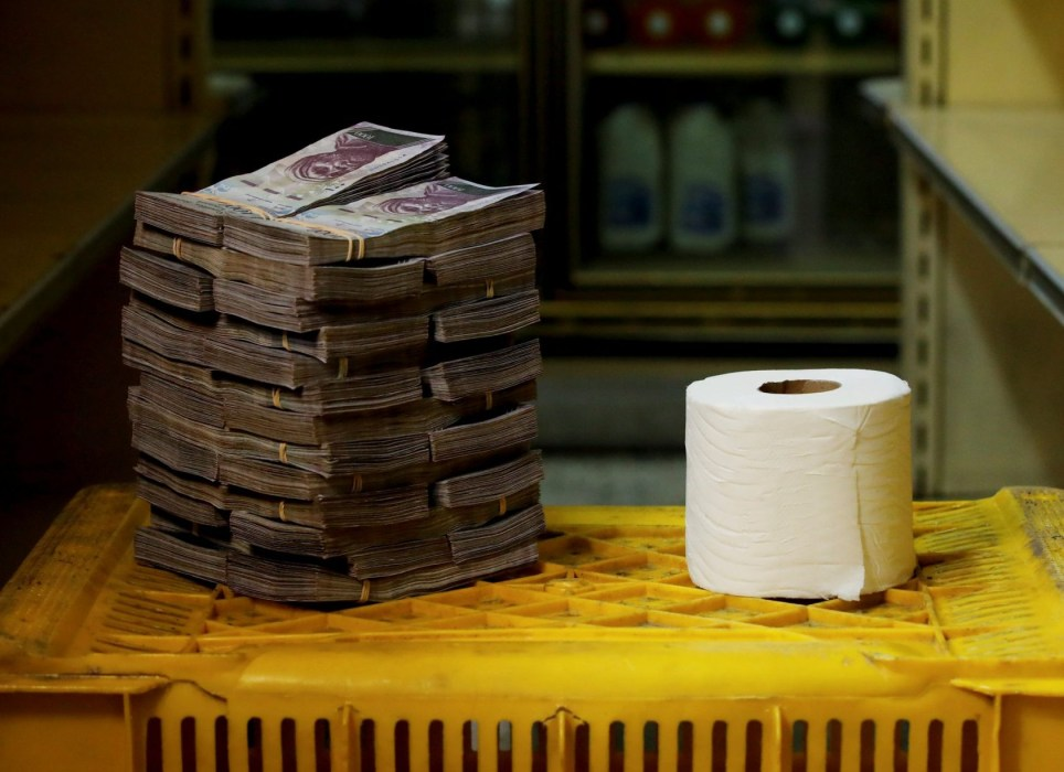 """A toilet paper roll is pictured next to 2,600,000 bolivars, its price and the equivalent of 0.40 USD, at a mini-market in Caracas, Venezuela August 16, 2018. It was the going price at an informal market in the low-income neighborhood of Catia. REUTERS/Carlos Garcia Rawlins SEARCH """"GARCIA ECONOMY"""" FOR THIS STORY. SEARCH """"WIDER IMAGE"""" FOR ALL STORIES."""