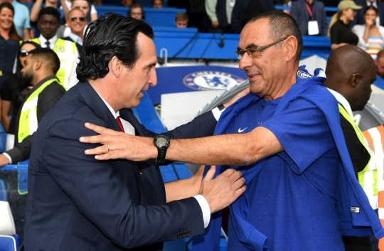 LONDON, ENGLAND - AUGUST 18: Unai Emery, Manager of Arsenal and Maurizio Sarri, Manager of Chelsea shake hands ahead of the Premier League match between Chelsea FC and Arsenal FC at Stamford Bridge on August 18, 2018 in London, United Kingdom. (Photo by Darren Walsh/Chelsea FC via Getty Images)