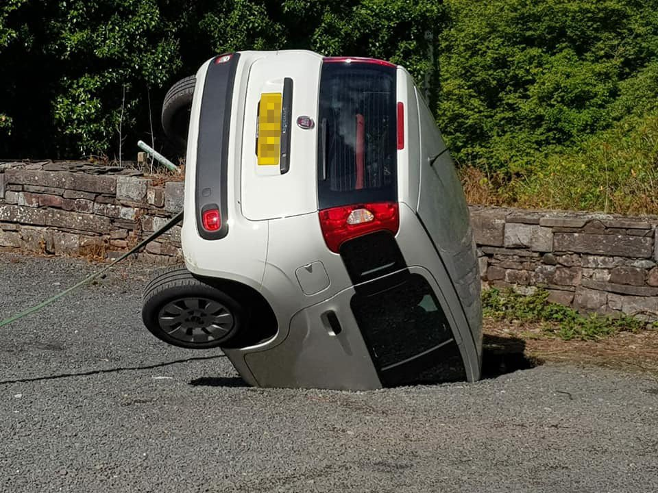 A woman left her car in a castle carpark - but returned to find it had been swallowed by a SINKHOLE.Karen Davies, 54, found her Fiat had disappeared bonnet first when she finished her shift working as a castle assistant. Her son Luke, 30, said his mother parked in her usual spot but was later told by colleagues about the sinkhole shock. PIC:Luke DaviesWALES NEWS SERVICE