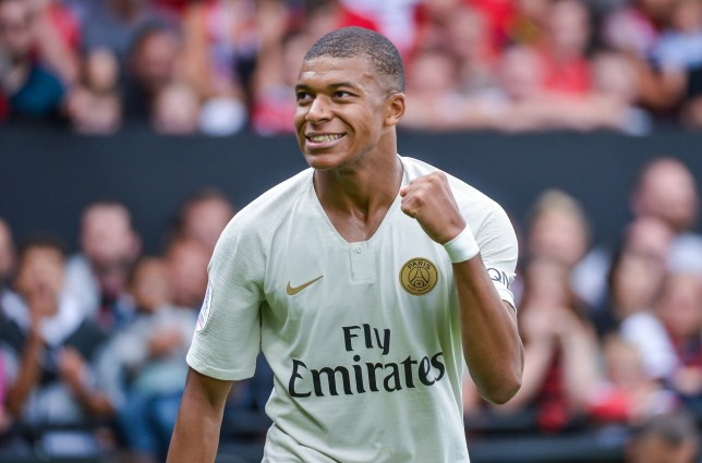 Kylian Mbappe of Paris Saint Germain celebrates hi first goal during the French Ligue 1 match between EA Guingamp and Paris Saint Germain at Stade du Roudourou on August 18, 2018 in Guingamp, France. (Photo by Baptiste Fernandez/Icon Sport via Getty Images)