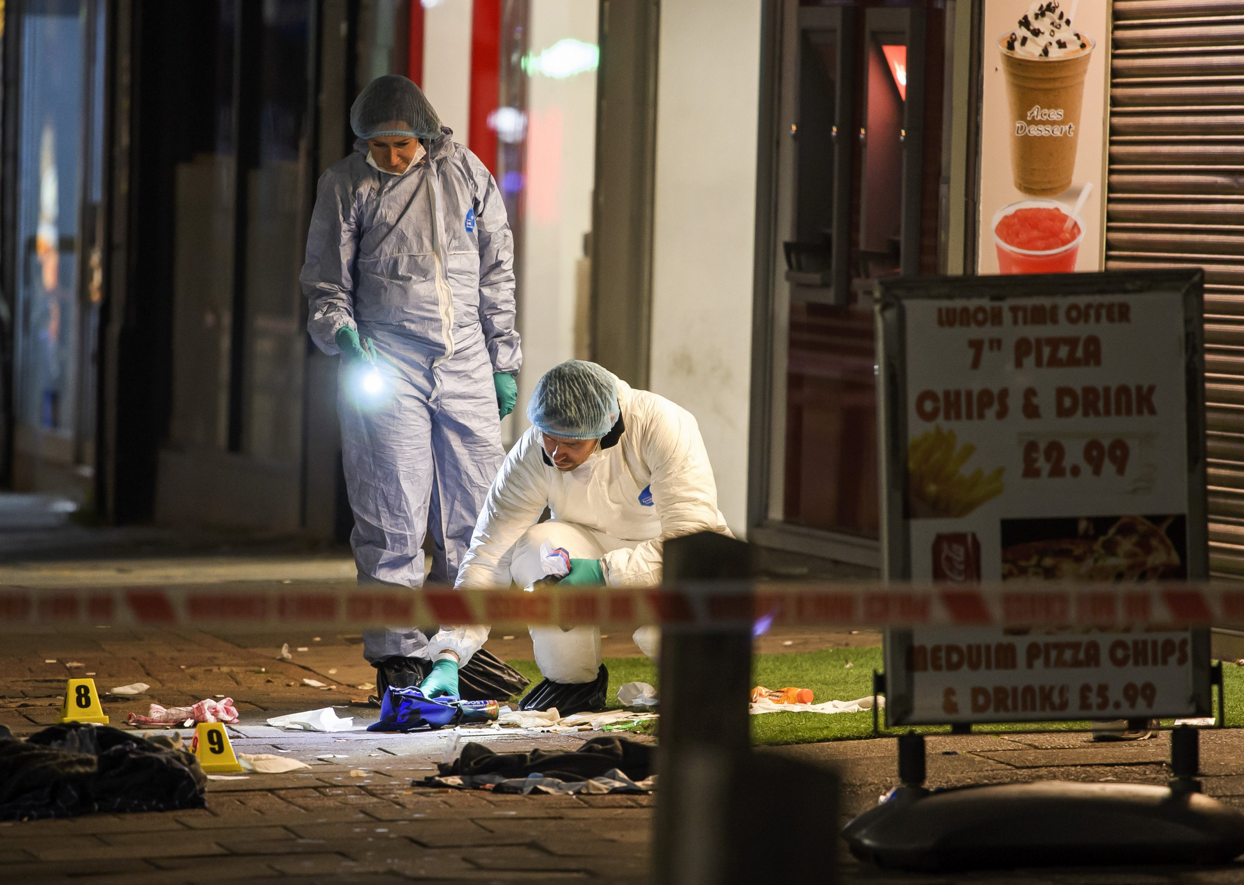 ? Licensed to London News Pictures. 21/08/2018. London, UK. Police forensics examine the scene of a shooting on Kingsbury Road in North London in which three people have been shot. No arrests have been made after emergency services rushed to the scene on Kingsbury High Road in Brent at 9.45pm. Photo credit: Ben Cawthra/LNP