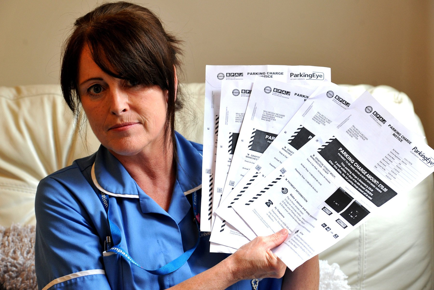 A nurse at Manchester Royal Infirmary received parking fines worth ?350 - despite having a monthly parking fee taken from her wages. Nicola McGarr, a ward sister in the Acute Medical Unit, was slapped with fines by private company Parking Eye during five shifts at the hospital. Caption: Nicola McGrarr who is a nurse at MRI has got five parking fines from a private parking firm despite paying a monthly parking fee out of her wages