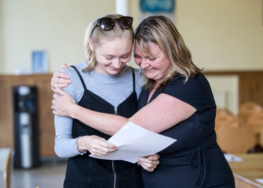 Joanna Milton (left) collects her GCSE results with mum Rachel Milton (right) at the Mount School York. PRESS ASSOCIATION Photo. Picture date: Thursday August 23, 2018. See PA story EDUCATION GCSE. Photo credit should read: Danny Lawson/PA Wire