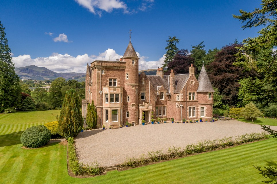 This classic Baronial mansion given an extraordinary pop art transformation by a Scottish artist has been put on the market for ??1.75 million. See SWNS story SWMANSION; Stuart McAlpine Miller and his interior designer wife, Nikki, bought The Gart in 2016 and set about restoring it. Period features such as panelling, fireplaces and high ceilings have all been respectfully retained, but the creative husband and wife have opened up the kitchen and dining room, transformed a top floor turret room into a home cinema. Their cutting edge and wildly imaginative ideas aligned with exquisite attention to detail and exacting standards of finish.