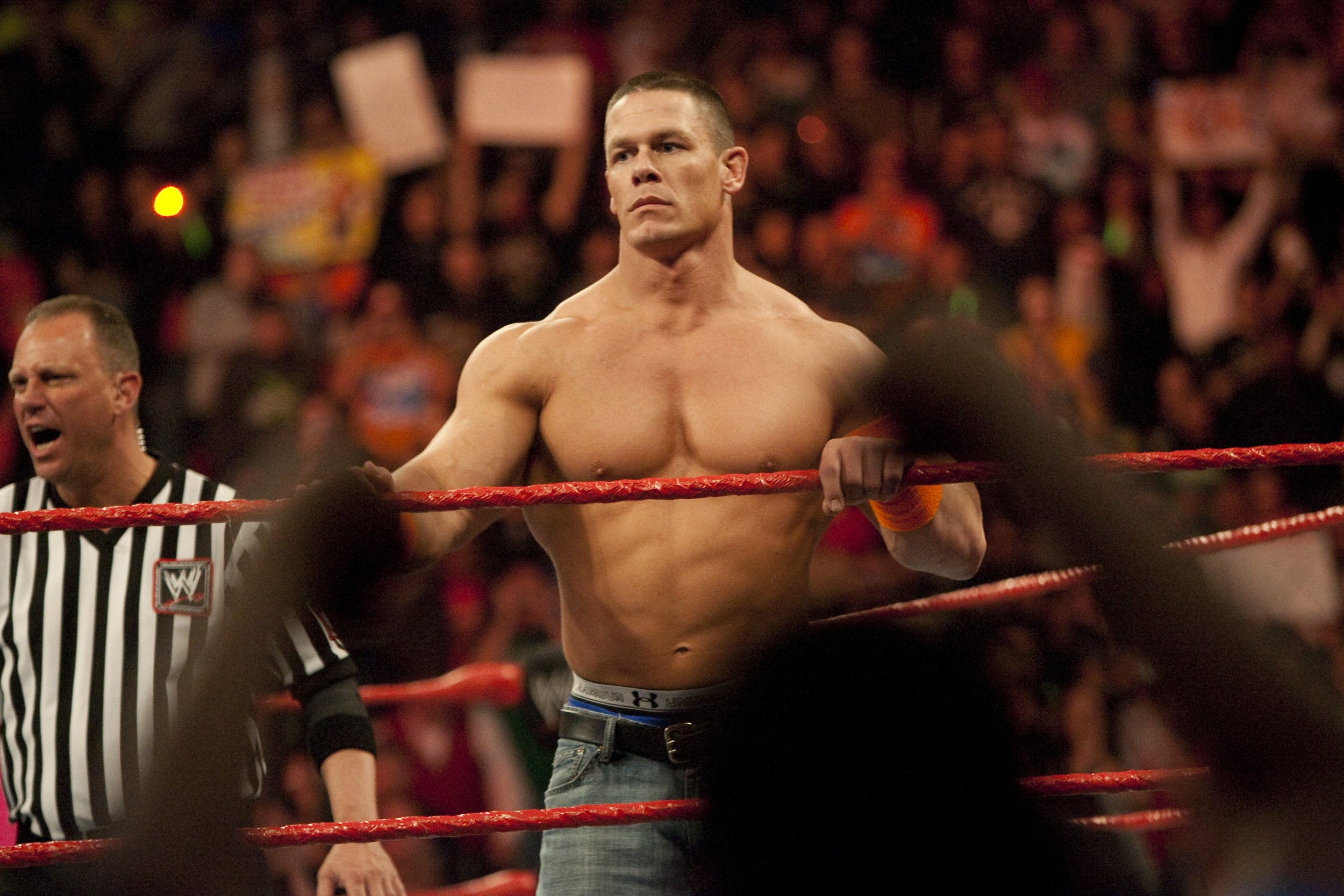 John Cena waits in the ring to face his opponents during WWE's Monday Night Raw at Rose Garden arena in Portland. (Photo by Chris Ryan/Corbis via Getty Images)