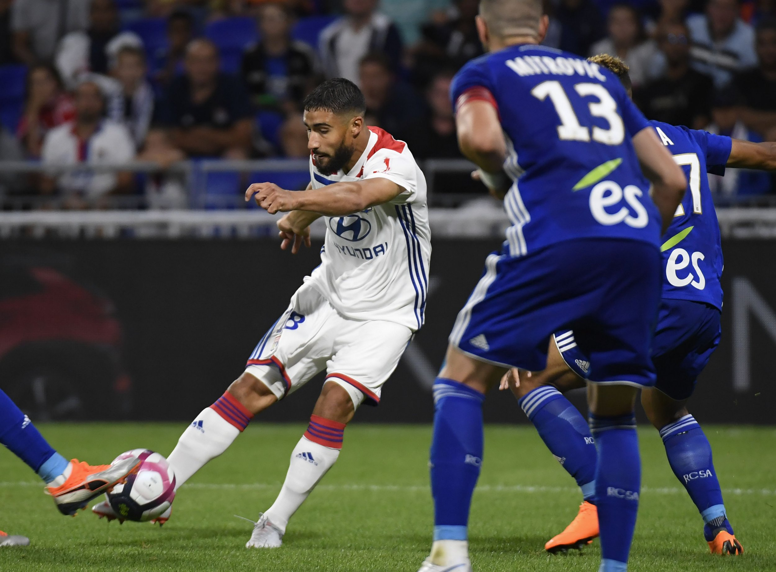 Lyon's French midfielder Nabil Fekir (L) shoots the ball during the French L1 football match between Lyon (OL) and Strasbourg (RCSA) on August 24, 2018, at the Groupama Stadium in Decines-Charpieu, near Lyon, central-eastern France. (Photo by PHILIPPE DESMAZES / AFP)PHILIPPE DESMAZES/AFP/Getty Images