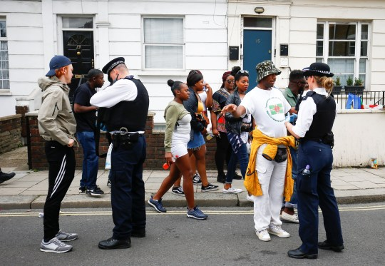 Police stop and search people during the Notting Hill Carnival in London, Britain August 27, 2018. REUTERS/Henry Nicholls