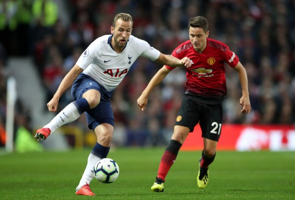 """Tottenham Hotspur's Harry Kane (left) and Manchester United's Ander Herrera battle for the ball during the Premier League match at Old Trafford, Manchester. PRESS ASSOCIATION Photo. Picture date: Monday August 27, 2018. See PA story SOCCER Man Utd. Photo credit should read: Nick Potts/PA Wire. RESTRICTIONS: EDITORIAL USE ONLY No use with unauthorised audio, video, data, fixture lists, club/league logos or """"live"""" services. Online in-match use limited to 120 images, no video emulation. No use in betting, games or single club/league/player publications."""