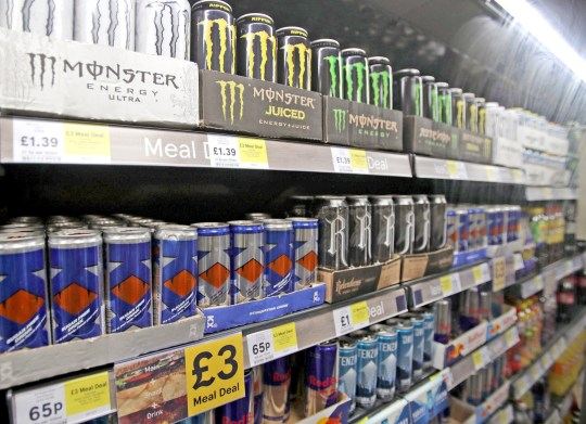 File photo dated 26/01/18 of shelves of energy drinks on sale. Children in England are to be banned from buying energy drinks under Government plans. PRESS ASSOCIATION Photo. Issue date: Thursday August 30, 2018. Youngsters in the UK reportedly consume more of the high-caffeine, sugar-loaded drinks than other children in Europe and the habit is harming their health and education, ministers fear. The restrictions will apply to drinks with more than 150mg of caffeine per litre, like popular brands Red Bull, Monster and Relentless. See PA story POLITICS Drinks. Photo credit should read: Yui Mok/PA Wire