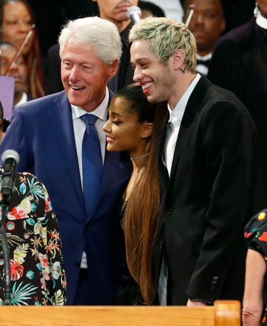 Former President Bill Clinton poses for a photo with Ariana Grande, center, and Pete Davidson, right, during the funeral service for Aretha Franklin at Greater Grace Temple, Friday, Aug. 31, 2018, in Detroit. Franklin died Aug. 16, 2018 of pancreatic cancer at the age of 76. (AP Photo/Paul Sancya)