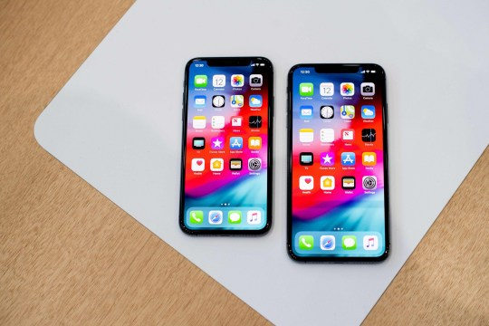 An Apple iPhone Xs Max (R) and iPhone Xs rest on a table during a launch event on September 12, 2018, in Cupertino, California. - New iPhones set to be unveiled Wednesday offer Apple a chance for fresh momentum in a sputtering smartphone market as the California tech giant moves into new products and services to diversify.Apple was expected to introduce three new iPhone models at its media event at its Cupertino campus, notably seeking to strengthen its position in the premium smartphone market a year after launching its $1,000 iPhone X. (Photo by NOAH BERGER / AFP)NOAH BERGER/AFP/Getty Images