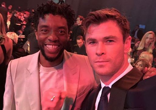 Chris Hemsworth and Chadwick Boseman tell Thanos to 'p*** off' as they have Avengers reunion at GQ Awards