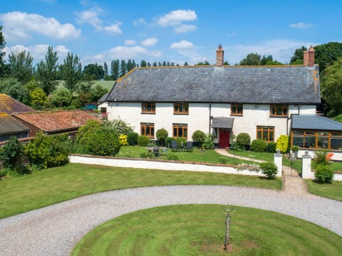 A farmhouse with its own wine vineyard is selling for £850,000