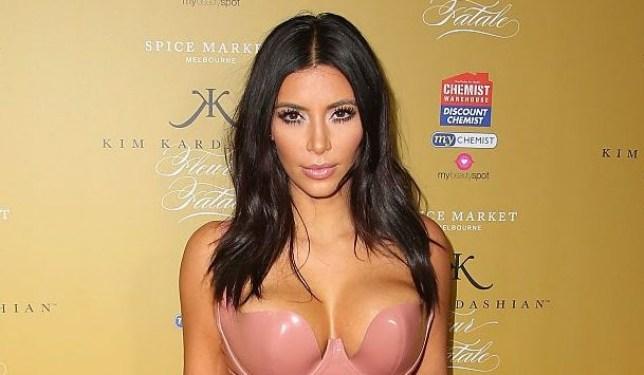 Kim Kardashian in latex at perfume launch