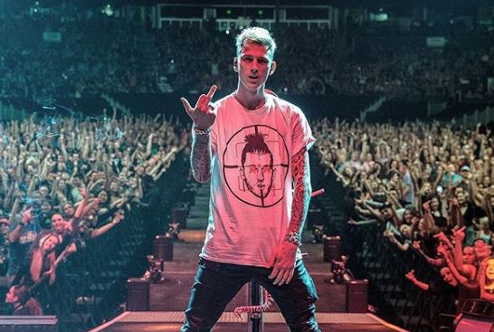 Machine Gun Kelly 'booed by crowd' as he performs Eminem diss track