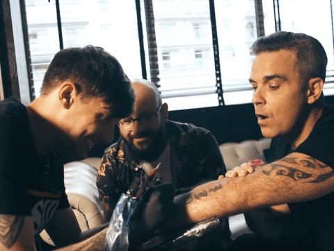 X Factor judges Robbie Williams and Louis Tomlinson are in a total bromance as they get matching tattoos