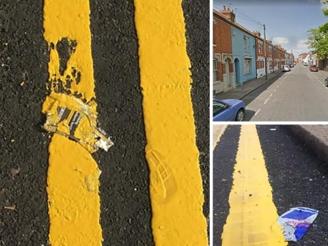 Council workers paint double yellow lines over rubbish instead of moving it