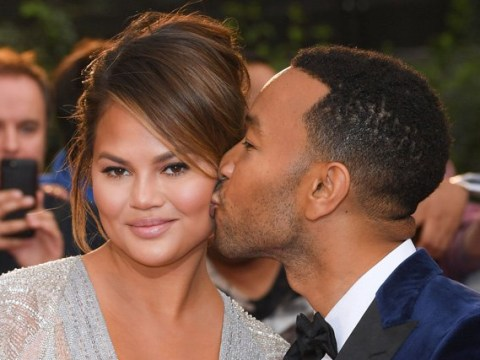 Chrissy Teigen and John Legend look seriously loved up as they share a kiss at GQ Men Of The Year Awards