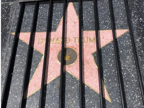 Plastic Jesus put Donald Trump's Hollywood star behind bars