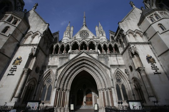The Royal Courts of Justice building, which houses the High Court of England and Wales, is pictured in London on February 3, 2017. / AFP / Daniel LEAL-OLIVAS (Photo credit should read DANIEL LEAL-OLIVAS/AFP/Getty Images)
