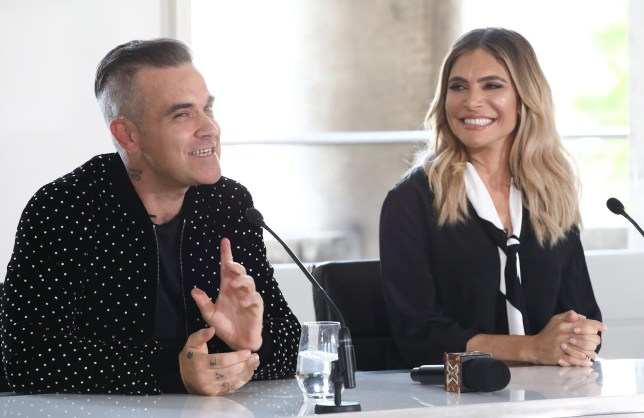 LONDON, ENGLAND - JULY 17: Robbie Williams and Ayda Field speak during The X Factor 2018 launch at Somerset House on July 17, 2018 in London, England. (Photo by John Phillips/Getty Images)