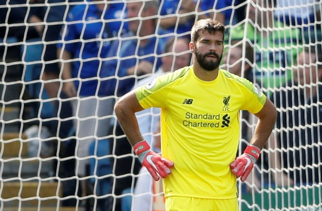 """Soccer Football - Premier League - Leicester City v Liverpool - King Power Stadium, Leicester, Britain - September 1, 2018 Liverpool's Alisson looks dejected after Leicester City's first goal Action Images via Reuters/Carl Recine EDITORIAL USE ONLY. No use with unauthorized audio, video, data, fixture lists, club/league logos or """"live"""" services. Online in-match use limited to 75 images, no video emulation. No use in betting, games or single club/league/player publications. Please contact your account representative for further details."""