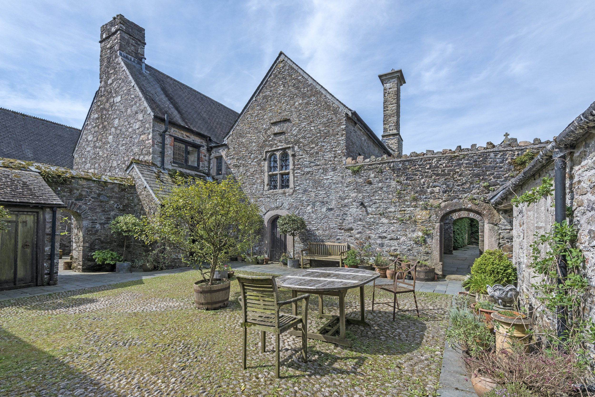 A historically-significant manor house which was once the home of Sir Walter Raleighs family has been put up for sale for ??2 million. Fardel Manor, which was recorded in the Domesday survey of 1086, has its own lake, swimming pool and CHAPEL. It is currently home to Father Benedict Ramsden, an Archpriest in the Russian Orthodox Church, who founded and runs an organisation called the Community of St Anthony and St Elias, and his wife, Lilah. But back in the early 17th Century, it belonged to Sir Walter Raleighs father - and the famous explorer and politician regularly visited the house, as did one of his ships captains, John Rolfe, who was the husband of the famous Pocahontas. Sir Walter regularly visited the house and continued to do so even in death. His grieving wife, Lady Elizabeth Raleigh, couldnt stand to be apart from her late husband and after he was executed in 1618 she would take his head everywhere she went - including Fardel Manor. The Grade I Listed home, which sits on the edge of Dartmoor in South Devon, now consists of four bedrooms, a drawing room, library/dining room, study, a screens room, which was the former Mediaeval Hall, a 13th century chapel and a screens passage.